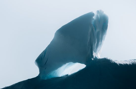 The endlessly complex landscape of abstract shapes and forms of icebergs in the Atlantic ocean at the west Greenland coast by Fine Art photographer Michael Schauer